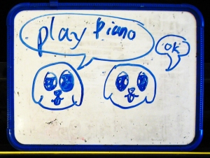student's drawing of puppies going to play piano
